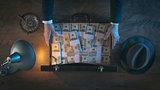 Rich businessman with dollar packs