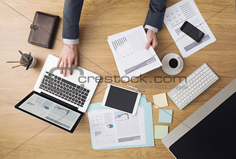 Businessman at work checking financial reports