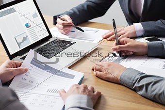 Business professionals analyzing financial data