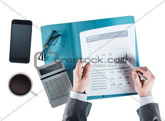 Business man checking a financial report