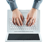 Blogger typing on a laptop