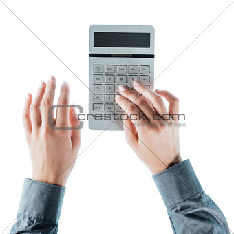 Business woman using a calculator