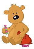 Teddy bear with a Christmas bag