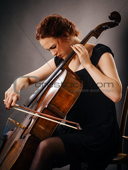 Cello player concentrating on her playing