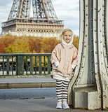happy active girl standing on Pont de Bir-Hakeim bridge in Paris
