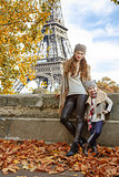 mother and child travellers on embankment near Eiffel tower
