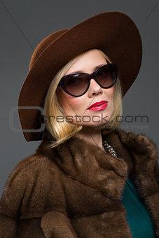 Beautiful mature woman in natural fur coat