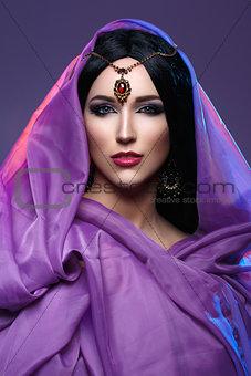Beautiful girl with arabic makeup