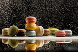 Colorful french macaroons on a black background