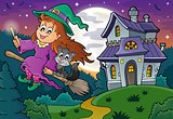 Cute witch on broom near haunted house