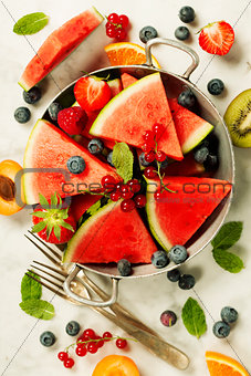 Watermelon, fruits, berries and mint leaves. Summer fruit concep