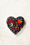 Heart shaped berries on marble background