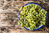 Ripe white grapes in a bowl.