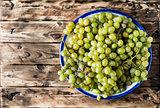 Ripe white grapes in a bowl.