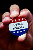 pin button with the text never forget