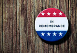 pin button with the text in remembrance