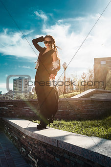 beautiful fashionable woman in the street