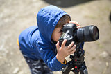 Kid with photo camera