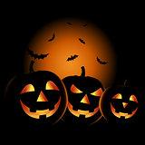 Halloween night with grinning pumpkins background