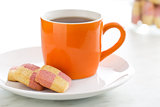 colored butter biscuits with tea mug