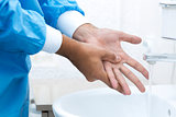 surgeon washing hands before surgery