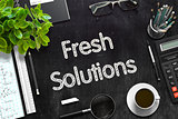 Fresh Solutions - Text on Black Chalkboard. 3D Rendering.