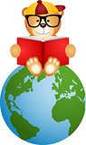 Teddy bear reading book sitting on globe
