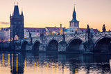 Prague city sunrise over Charles Bridge on Vltava river