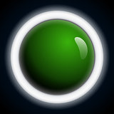 Abstract dark background with illuminated ring and a glossy green ball.
