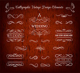 Vintage wedding elements and page decoration. Ornate frames and scroll element. Isolated on red wooden background