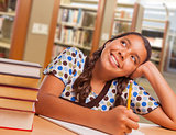 Hispanic Girl Student Daydreaming While Studying in Library