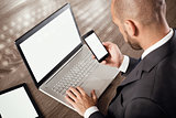 Busy businessman works with technology
