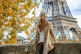 tourist woman looking into distance on embankment in Paris