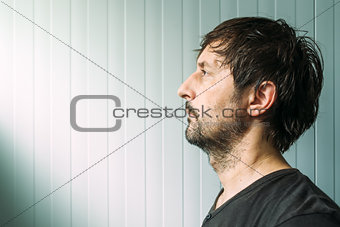 Adult unshaven casual male profile portrait with copy space