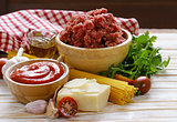 Ingredients for pasta with bolognese sauce (meat, tomato sauce, garlic, olive oil)