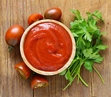 tomato sauce (ketchup) in a wooden bowl