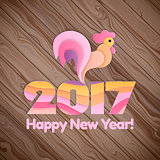 Happy New Year 2017 on the wooden background.