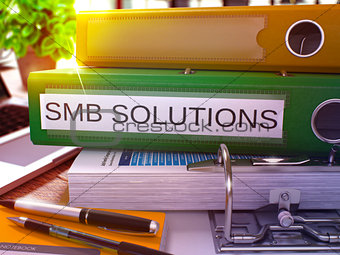 Green Office Folder with Inscription SMB Solutions. 3D Rendering.