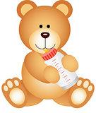 Teddy bear baby drinking milk from bottle