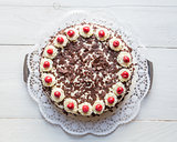 Black Forest cake on white wooden
