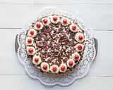 Black Forest cake on white wooden