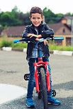 Cute boy riding a bike