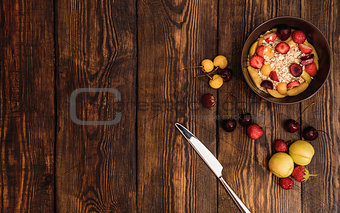 Breakfast table with porridge, ripe fruits and berries