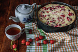 Breakfast with strawberry pie, black tea and berries