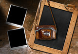 Old Camera with Blackboard and Empty Photos
