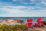 Red chairs facing Keji Seaside beach (South Shore, Nova Scotia,