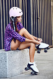 Young woman wearing roller skating shoe outdoors lifestyle portrait