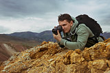 Man photographer camera mountains concept