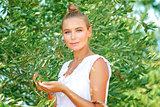 Beautiful girl in olive garden