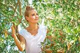 Dreamy woman in olive garden